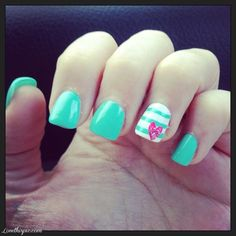 Did this with a pretty grey polish, mint green stripes on the ring finger with a white heart. The other nails had a touch of silver glitter polish at the base - LOVE!!!