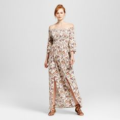 You'll be suited for any adventure in the sun wearing the Smocked Off-the-Shoulder Maxi Dress from Xhilaration™. With a double-slit front and breezy silhouette, this lovely maxi dress will comfortably take you from a weekend at the farmers market to a day date with ease. The allover floral pattern and smocked bodice bring a subtle vintage charm to your style, while bell sleeves keep things current. Pair with strappy sandals and a choker necklace and toss on a denim jacket for a c...