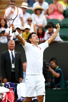 Kei Nishikori of Japan celebrates winning his Men's Singles fourth round match against Ernests Gulbis of Latvia on day seven of the Wimbledon Lawn Tennis Championships at All England Lawn Tennis and Croquet Club on July 9, 2018 in London, England.