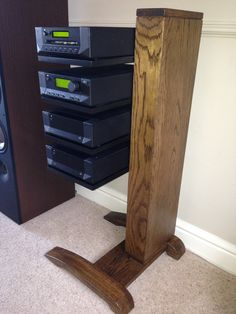 Solid oak hi-fi stand with cantilever shelves