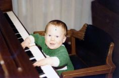 Fall Out Boy drummer Andy Hurley playing on the family piano in March 1981, when he was 10 months old.
