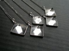 Clear quartz pyramid pendant on a rhodium plated chain. You can choose the exact pendant you would like, and the length of the chain in the product options. Measurements: Stone: The largest one is number 7. It is approximately 3/4 x 3/4 (20mm х 20mm) The smallest one is number 8. It is