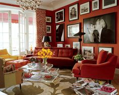 Walls painted in Benjamin Moore's Million Dollar Red bring a sharp, sophisticated look to this Manhattan living room.