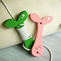 WM rubber Sprout earphone cable organizer winder  (http://www.fallindesign.com/wm-rubber-sprout-earphone-cable-organizer-winder/)
