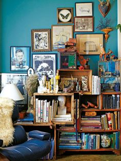 May need to do something similar to store my art supplies because I can't afford a large bookcase/shelving unit. I think the unifying colors (aqua and brown/orange) and the flow of the pictures with the furniture help it be less overwhelming.