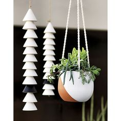 The white and black ceramic matte chimes look more like a piece of art than an outdoor accessory.