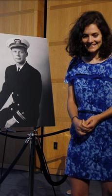 Rose Schlossberg walks past a photograph of her grandfather U.S. President John F. Kennedy, during a ceremony to announce the name of the new U.S. Navy ...