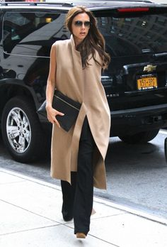 Victoria Beckham uber-chic in camel sleeveless coat #StreetStyle