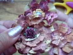 vintage paper Flower tutorial. Made from an old 1940's or 50's paperback. These are cute!