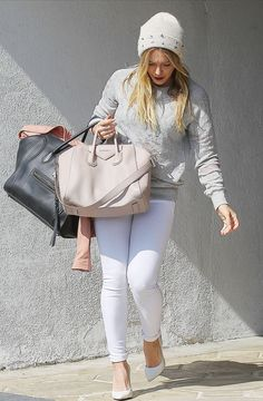 Shop Hilary Duff's look for $92:  http://lookastic.com/women/looks/beanie-and-crew-neck-sweater-and-shopper-handbag-and-skinny-jeans-and-heels/1271  — White Embellished Beanie  — Grey Crew-neck Sweater  — Beige Leather Shopper Handbag  — White Skinny Jeans  — White Leather Heels