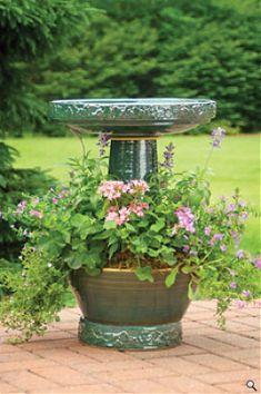 """Birdbath & Planter Set. Founded in 1923 by the Burley brothers, Burley Clay products are made using a unique blend of the finest clay from their mines in southeastern Ohio. Their bird baths and planters are then created using an old-fashioned, hand-made process called """"jiggering"""" to ensure quality craftsmanship and attention to detail. All Burley Clay products are designed and created in Roseville, Ohio. Made in USA."""