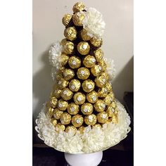 Labor of love.. Handmade ferrero rocher chocolate tower for entrance table ..
