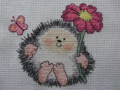 Cross-Stitched Hedgehog with Flower