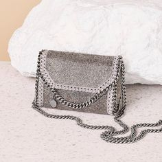 """""""The #Falabella gets the evening treatment courtesy of our Holiday Gift Guide. Shop at #StellaMcCartney.com. #StellasWorld"""""""
