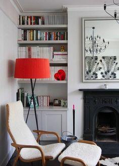 Floor lamp. Inbuilt shelves and cupboards.