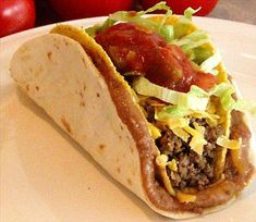 Double Decker Tacos from Food.com: Soft taco on the outside, crispy taco on the inside. These are easier to eat than a regular taco. The soft taco keeps everything together. It's a very filling taco. My kids LOVE these tacos!