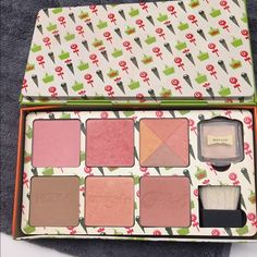 Benefit Cheeky Sweet Spot Only used a handful of times and most colors have the name still visible in the imprint. The highlighter ( Watt's Up) was used twice and the brush was never used. Please note due it's in a metal case which is slightly bent. Does not impact using though. Benefit Makeup Blush