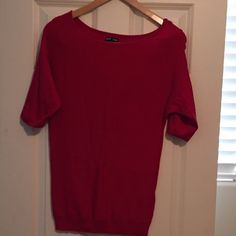 Express short sleeve sweater. Super cute short sleeved sweater.  Very Soft.  Has buttons down the right arm sleeve.  The color is a cross between a red and pink. Express Sweaters Crew & Scoop Necks