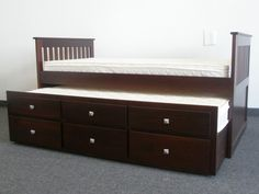 Captains Bed Cappuccino Trundle Rolls Out.... I would get a twin & make it into a day bed.