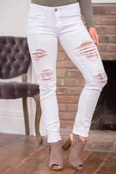 These sweet white jeans are simply a must-have for spring - and the edgy distressed look is the perfect way to add a pop of style to sweet pastels tunics and floral print blouses!