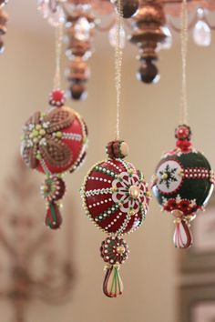 Cookie ornaments hanging from my chandelier - Fully 3-D and edible! Globe cookie ornaments made with gingerbread; then dipped in egg glaze (or royal icing); then embellished with embossed cookies, frosting sheet cutouts, more icing, and/or dragees!
