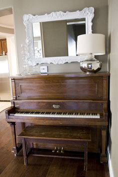 The Piano with mirror and a few family heir looms on it - now we need granny to play the carols on it for christmas..  eclectic living room by Michelle Hinckley