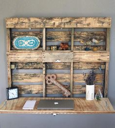 Pallet Wood Fold-Out Desk by Workman's Palette When it's folded up, a chalkboard-painted portion is displayed for jotting down notes and important reminders
