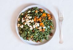 This vegan spicy peanut kale salad features tender roasted sweet potato and a salty, spicy, irresistable peanut dressing! Sweet Potato Kale, Roasted Sweet Potatoes, Kale Salad, Soup And Salad, Whole Food Recipes, Vegan Recipes, Butter Rice, Super Greens, Chia Pudding
