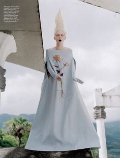 Check out the Academy-award-winning actress Tilda Swinton wearing a Maison Martin Margiela off-the-shoulder evening gown and gloves from the Spring-Summer 2013 collection, during her cover shoot for May's W magazine, USA.    Photographed by Tim Walker and styled by Jacob K.