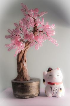 maneki neko & cool money tree! I saw a one metre tall beaded gemstone money tree at Cranbourne, but it was $269