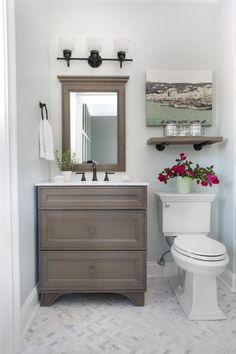 Small guest bathroom makeover...it's a great transformation with marble floor and shower and open, clean feeling! Bower Power