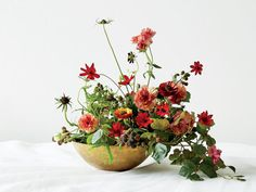 """""""I left some negative space in the bowl, which helps bring a lightness to an otherwise rich arrangement,"""" Patterson says. Floral design by Fox Fodder Farm."""