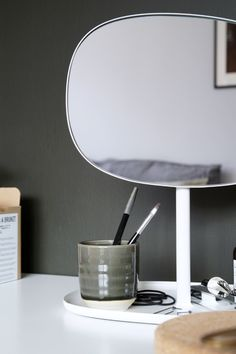 Dark green obsessed. Dark green wall for a moody bedroom. Normann Copenhagen flip mirror on the make up table   - Hege in France
