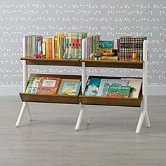 Shop Danish Modern Walnut & White Wide Bookcase. This wide bookcase balances the functionalism of Danish design with the enduring cool of mid-century style. Designed exclusively for us by Adam Greber, it features a striking yet versatile two-tone finish.