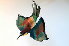 This bird is made out of PAPER.
