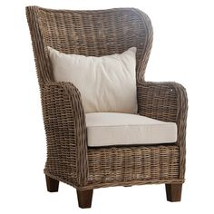 Perfect for curling up with your latest book club read or a cup of coffee, this rattan accent chair features a mahogany wood frame and high back.