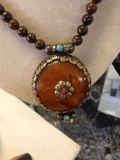 Hand beaded pyrite and amber pendant on Etsy, $105.00