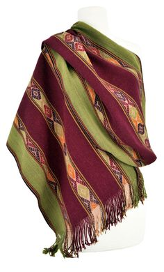 These exquisitely woven shawls have meticulously embroidered geometric bands. This technique is unique to the village of Sallac, and the finished result looks as though it was produced by a supplementary weft weaving technique. The naturally-dyed colors are rich anddeep: maroon, deep purple, deep rusty-orange,and muted accents of lighter gold, green, red, and orange. Sophisticated […]