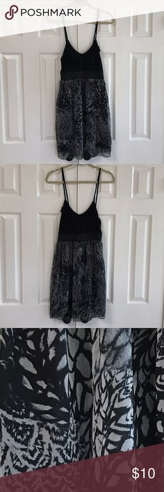 Max black print dress 100% polyester machine wash cold.  Bodice is solid black skirt is black and gray.  Waistband is 2 inch elastic band. Skirt is completely lined.  Close-up of skirt design in photo 3.   Top Boris has two rows of ruffles   Photo 5Gently washed and worn with no rips no stains.  Listed under Forever 21. Tag says Max. Forever 21 Dresses Mini