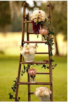 Cute for a rustic or country wedding - an old ladder, assorted pots and fresh flowers and greenery for altar area or ceremony backdrop.