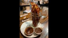 Delicious jar of bacon with sweet dipping sauces! Crafted The Art of The Taco in Greensboro, NC also has delicious tacos, burgers and more! Fun environment a. Bacon Videos, Burgers And More, Dipping Sauces, Tacos, Environment, Jar, Restaurant, Sweet, Check
