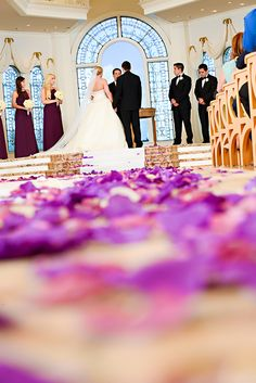 Purple and pink rose petals line the aisle in Disney's Wedding Pavilion