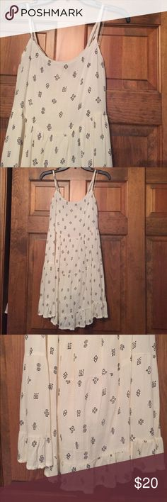 NWOT! Cream sundress with black tribal design! NWOT! Cream/off white sundress with black tribal design! Bought and never wore or washed! Crisscross back strap detail, very lightweight material with cream slip underneath. Great for summer weather! Dresses Midi