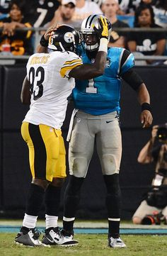 Carolina Panthers quarterback Cam Newton (1) is hugged by Pittsburgh  Steelers linebacker Jason Worilds 973b1e2ff