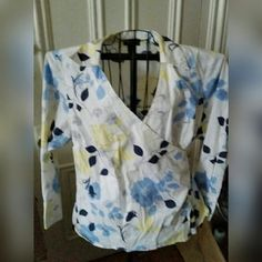 Lane Bryant long sleeve wrap shirt White with yellow & blue floral designs. Ties at the side.  97% cotton, 3% spandex Size 18/20 Lane Bryant Tops Blouses