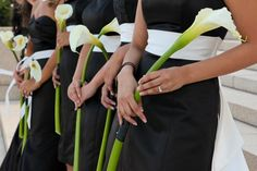 "Single calla lily ""bouquets"" are a great option for weddings on a tight budget. Photo: Nat Wongsaroj Photography"