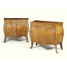 A pair of George III ormolu-mounted padouk and rosewood bombé commodes Circa 1775, attributed to Pierre Langlois, the mounts attributed to Dominique Jean the quarter-veneered serpentine tops above a drawer fitted with a leather-lined slide, each pair of doors enclosing cupboard space, on splayed legs