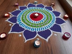 Simple and easy freehand flower rangoli designs with colours, Diwali rangoli designs by Shital Daga Indian Rangoli Designs, Rangoli Designs Latest, Rangoli Designs Flower, Rangoli Border Designs, Small Rangoli Design, Rangoli Designs Images, Rangoli Ideas, Rangoli Designs With Dots, Flower Rangoli