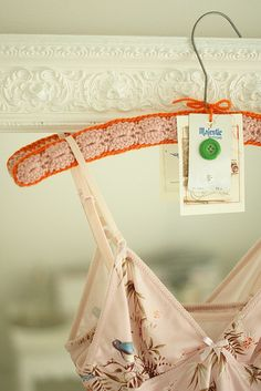 Crochet Hanger made by Dottie Angel. Love the pink-orange combination.