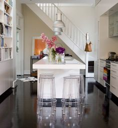 love the dark floors.. the stools.. the staircase coming straight into the kitchen.. everything really.